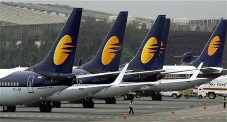 Jet Airways aircraft stand on tarmac at the domestic airport terminal in Mumbai September 9, 2009. REUTERS/Punit Paranjpe/Files