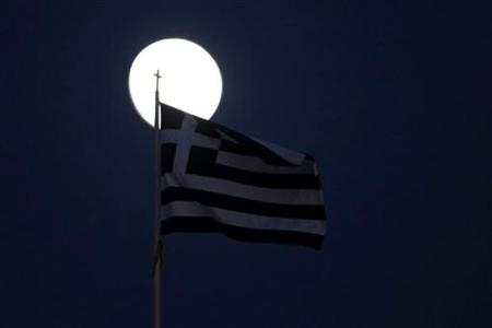 A Greek flag flutters in front of the moon in Athens November 26, 2012. Euro zone finance ministers and the International Monetary Fund began their third attempt in as many weeks to release emergency aid for Greece on Monday, with policymakers saying a write-down of Greek debt is off the table for now. REUTERS/Yorgos Karahalis (GREECE - Tags: POLITICS BUSINESS)