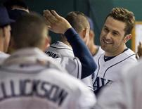 Tampa Bay Rays teammates congratulate Evan Longoria (R) in the dugout after his solo home run during the fourth inning of a MLB American League baseball game against the Baltimore Orioles in St. Petersburg, Florida, October 3, 2012. REUTERS/Steve Nesius