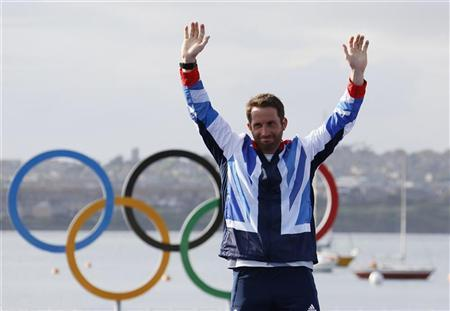 Gold medallist Britain's Ben Ainslie smiles during the men's finn class one person dinghy (heavyweight) sailing medal race victory ceremony at the London 2012 Olympic Games in Weymouth and Portland, southern England August 5, 2012. REUTERS/Pascal Lauener