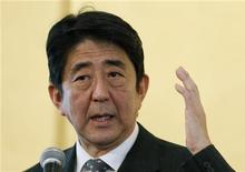 "Shinzo Abe, the head of Japan's main opposition Liberal Democratic Party, speaks during a lecture entitled,""The path to the rejuvenation of Japan,"" in Tokyo November 15, 2012. REUTERS/Yuriko Nakao"