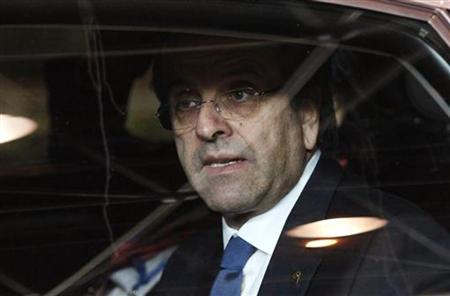 Greece's Prime Minister Antonis Samaras leaves the European Union leaders summit discussing the European Union's long-term budget in Brussels November 23, 2012. REUTERS/Sebastien Pirlet (BELGIUM - Tags: POLITICS BUSINESS)