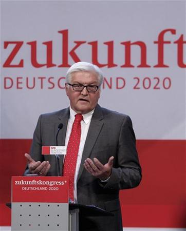 Leader of cparliamentary faction Frank-Walter Steinmeier makes a point during his speech at a SPD parliamentary group congress in Berlin, September 15, 2012. Part of the slogan in the background reads: ''Future''. REUTERS/Tobias Schwarz (GERMANY - Tags: POLITICS)