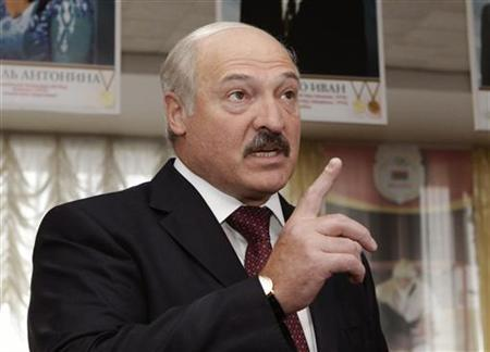 Belarusian President Alexander Lukashenko speaks with the media during the parliamentary election at a polling station in Minsk, September 23, 2012 REUTERS/Vasily Fedosenko