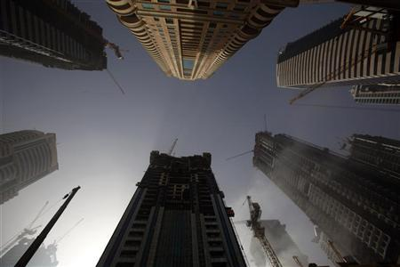 An early morning view of apartment blocks under construction in Dubai Marina March 14 2009. REUTERS/Steve Crisp