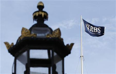 A flag flies over the former headquarters and registered office of the Royal Bank of Scotland (RBS) in Edinburgh, Scotland March 29, 2012. REUTERS/David Moir