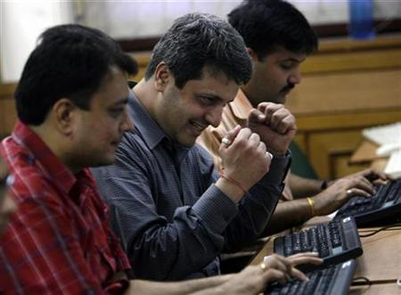 A broker reacts during trading at a stock brokerage firm in Mumbai September 2, 2008. REUTERS/Arko Datta/Files
