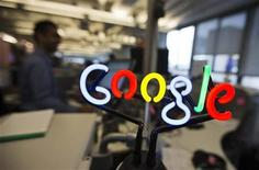 A neon Google logo is seen as employees work at the new Google office in Toronto, November 13, 2012. REUTERS/Mark Blinch (CANADA - Tags: SCIENCE TECHNOLOGY BUSINESS LOGO)