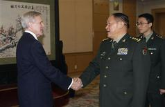United States Secretary of the Navy Ray Mabus (L) shakes hands with China's Defense Minister Liang Guanglie during a meeting at the Bayi Building, in Beijing November 27, 2012. REUTERS/Jason Lee