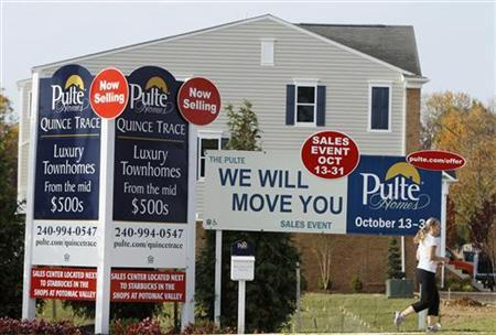 A woman jogs by new housing construction in Darnestown, Maryland, October 23, 2012. REUTERS/Gary Cameron