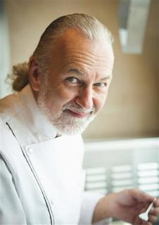 Chef Hubert Keller, author of ''Souvenirs: Memories, Stories, and Recipes from My Life'', is shown in a 2011 file handout photo taken in Las Vegas, Nevada. Chef, restaurateur and television personality Keller is known for his modern approach to French cuisine, but in his third book he casts a backward glance over his peripatetic culinary history. REUTERS/Eric Wolfinger/Handout