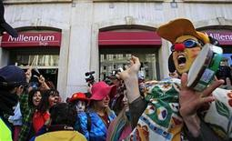 Demonstrators walk out from a bank during an anti-austerity protest in front of Portugal's parliament in Lisbon November 27, 2012. REUTERS/Jose Manuel Ribeiro