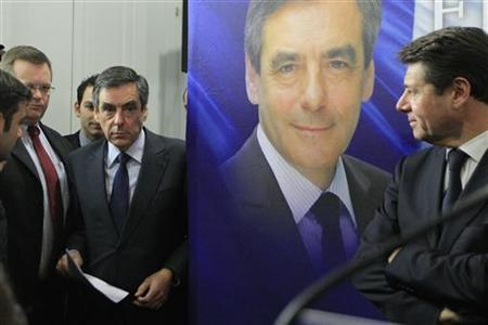 Francois Fillon (2ndL), former French prime minister and former candidate for the leadership of the UMP political party, arrives to attend a new conference in Paris November 27, 2012. REUTERS/Gonzalo Fuentes