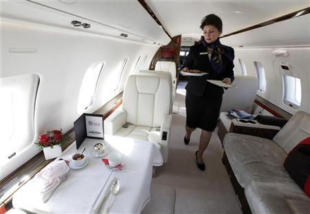 A Vistajet flight attendant prepares a breakfast in a Bombardier 605 aircraft prior to the opening of the Annual European Business Aviation Convention & Exhibition (EBACE) at Cointrin airport in Geneva May 17, 2011. REUTERS/Denis Balibouse
