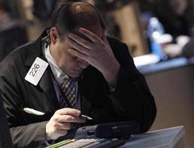 A trader works on the floor of the New York Stock Exchange, November 27, 2012. REUTERS/Brendan McDermid