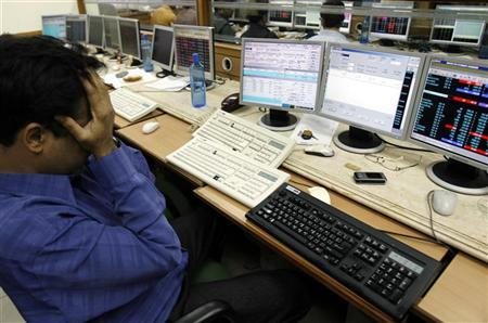 A broker reacts while trading at a stock brokerage firm in Mumbai February 7, 2008. REUTERS/Arko Datta/Files