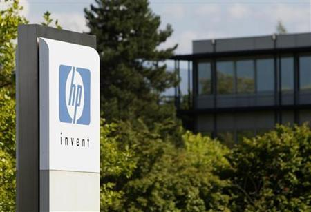 An HP Invent logo is pictured in front of Hewlett-Packard international offices in Meyrin near Geneva August 4, 2009. REUTERS/Denis Balibouse