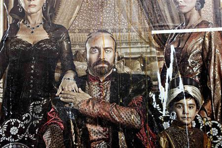 A billboard advertising the TV series ''The Magnificent Century'' is seen after being damaged by eggs thrown by pro-Islamic protesters in Istanbul in this January 9, 2011 file photo. The hit TV show about the Ottoman Empire's longest-reigning Sultan has raised a political storm in Turkey, with Prime Minister Tayyip Erdogan urging legal action over historical inaccuracies and the opposition accusing him of artistic tyranny. REUTERS/Murad Sezer