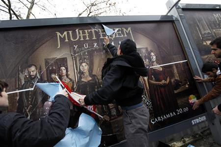 Demonstrators throw eggs and attack billboards advertising the TV series ''The Magnificent Century'' during a protest near the Show TV headquarters in Istanbul in this January 9, 2011 file photo. REUTERS/Murad Sezer