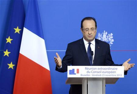 French President Francois Hollande speaks during a news conference at the end of an EU leaders summit discussing the EU's long-term budget at the European Union (EU) council headquarters in Brussels November 23, 2012. REUTERS/Eric Vidal