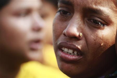 A worker cries during a protest against the death of her colleagues after a devastating fire in a garment factory which killed more than 100 people, in Savar November 26, 2012. REUTERS/Andrew Biraj