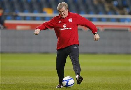 England's coach Roy Hodgson kicks a ball during a training session at the Friends Arena in Stockholm November 13, 2012. REUTERS/Phil Noble