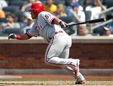 Philadelphia Phillies Carlos Ruiz hits an RBI single against the New York Mets during the eighth inning of their MLB National League baseball game at CitiField in New York, July 4, 2012. REUTERS/Adam Hunger