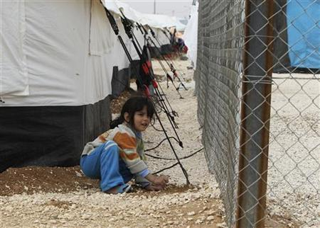 A Syrian refugee girl plays outside her parents' tent during a visit by United Nations humanitarian chief Valerie Amos at the Al Zaatri refugee camp in the Jordanian city of Mafraq, near the border with Syria, November 27, 2012. REUTERS/Ali Jarekji