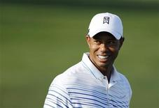 Tiger Woods of the U.S. smiles on the driving range at the World Challenge golf tournament in Thousand Oaks, California, November 27, 2012. REUTERS/Danny Moloshok