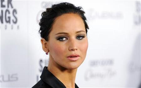 Actress Jennifer Lawrence arrives at a special screening of her new movie ''Silver Linings Playbook'' in Beverly Hills, California November 19, 2012. REUTERS/Gus Ruelas