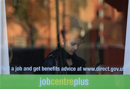 A woman enters an employment centre in Leicester, central England, October 20, 2010. REUTERS/Darren Staples