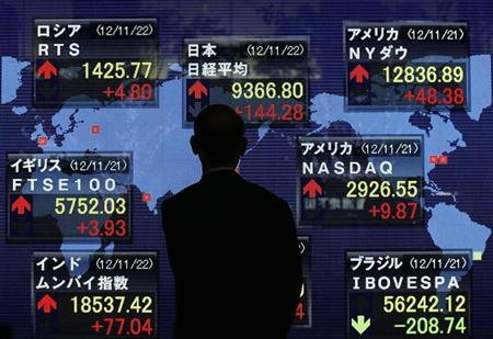 A man looks at stock index board showing various countries stock price index outside a brokerage in Tokyo November 22, 2012. REUTERS/Kim Kyung-Hoon