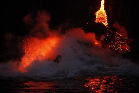 Waves crash over lava as it flows into the ocean near Volcanoes National Park in Kalapana, Hawaii on November 27, 2012. A volcano on Hawaii's largest isand is spilling lava into the ocean, creating a rare and spectacular fusion of steam and waves that officials said on Tuesday could attract thrill seeking visitors if it continues. REUTERS/Hugh Gentry