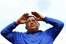 Президент Венесуэлы Уго Чавес во время предвыборной кампании в Маракае, 3 октября 2012 года. Президент Венесуэлы Уго Чавес, перенесший в прошлом году на Кубе операцию по удалению раковой опухоли, в ближайшее время вновь отправится на Остров свободы для прохождения курса лечения. REUTERS/Jorge Silva