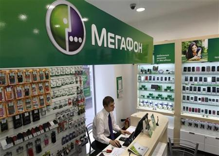 An employee works inside a MegaFon shop in St. Petersburg November 15, 2012. MegaFon, Russia's No. 2 mobile phone operator, wants to raise $1.7-$2.3 billion from a planned share listing in London and Moscow, it said as it kicked off an investor roadshow in New York. REUTERS/Alexander Demianchuk (RUSSIA - Tags: BUSINESS TELECOMS)