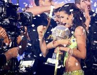 "Contestants Melissa Rycroft and Tony Dovolani (C) hold the mirror ball trophy as they are crowned champions on the season finale of ABC's ""Dancing with the Stars: All-Stars"" in Los Angeles November 27, 2012, in this ABC publicity photograph. Rycroft was crowned champion on Tuesday, propelled by perfect scores from the judges and fan votes which spelled victory for the television host. Picture taken and released on November 27. REUTERS/Adam Taylor/ABC/Handout"