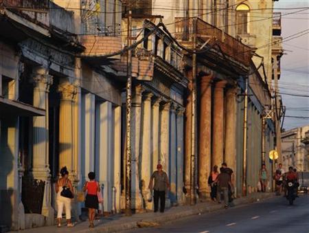 People walk on a street of Havana October 29, 2010. REUTERS/Desmond Boylan/Files