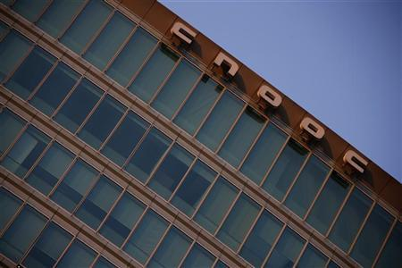 A logo of China National Offshore Oil Corp (CNOOC) is seen at the top of its headquarters in Beijing November 14, 2012. REUTERS/Petar Kujundzic