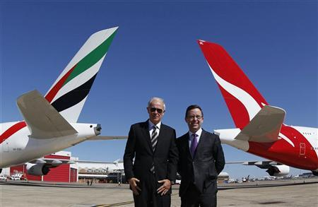 Qantas Chief Executive Officer Alan Joyce (R) and Emirates President Tim Clark pose for pictures at Kingsford Smith international airport in Sydney September 6, 2012. REUTERS/Daniel Munoz