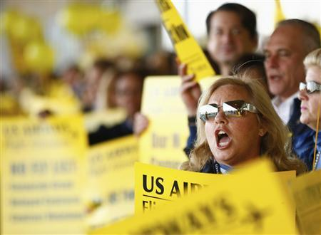 U.S. Airways Flight attendant Barbara de la Portilla yells along with other attendants as they picket at Charlotte Douglas International Airport in Charlotte, North Carolina in this November 14, 2012, file photo. REUTERS/Chris Keane/Files