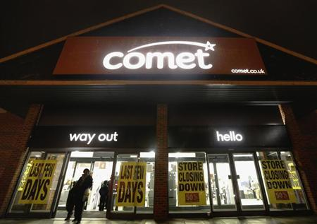 People walk out of a Comet store in Guildford, southern England November 17, 2012. REUTERS/Luke MacGregor