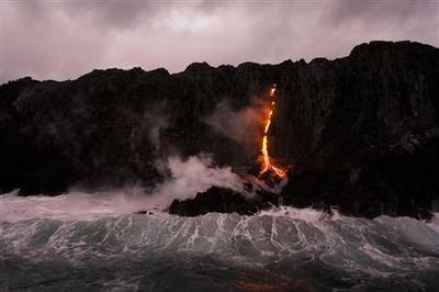 Lava flows to the ocean in Hawaii, creating rare...