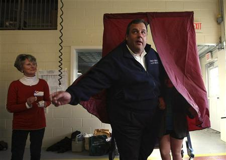 Poll worker Annie Barr watches as Governor Chris Christie exits the voting booth with his daughter Bridget, 8, at the Mendham Emergency Services Building in Mendham, New Jersey, November 6, 2012 in this handout photo courtesy of the governor's office. REUTERS/New Jersey Governor's Office/Tim Larsen/Handout