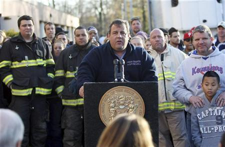 Governor Chris Christie holds a press conference at a Relief Center at the Joseph R. Bolger Middle School in the wake of Hurricane Sandy in Keansburg, New Jersey November 5, 2012, in this handout image courtesy of the governor's office. REUTERS/New Jersey Governor's Office/Tim Larsen/Handout