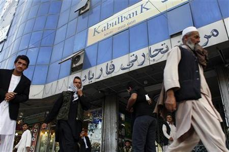 Afghan people walk past a Kabulbank branch in Kabul September 14, 2010. REUTERS/Andrew Biraj