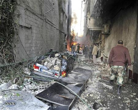 A crowd gathers at the site of a blast in Jaramana district, near Damascus, in this handout photograph released by Syria's national news agency SANA November 28, 2012. REUTERS/Sana