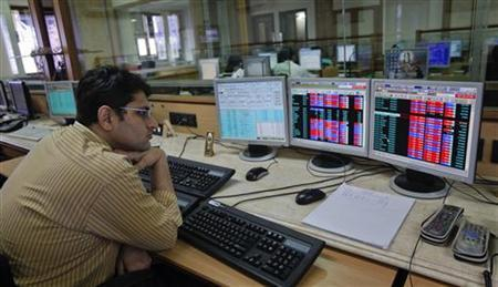 A broker monitors share prices at a brokerage firm in Mumbai August 9, 2011. REUTERS/Danish Siddiqui/Files