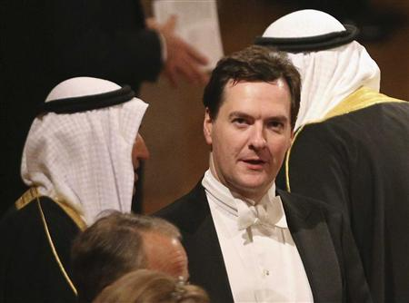 Britain's Chancellor of the Exchequer George Osborne (C) arrives for a State Banquet for the Emir of Kuwait, Sheikh Sabah al-Ahmad al-Sabah at Windsor Castle, in Windsor, southern England November 27, 2012. REUTERS/Oli Scarff/Pool