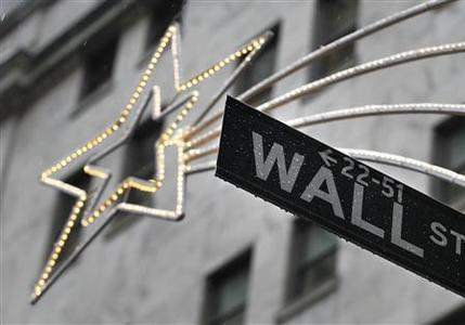 A holiday decoration is seen over Wall St. sign outside the New York Stock Exchange, November 27, 2012. REUTERS/Brendan McDermid (UNITED STATES - Tags: BUSINESS)