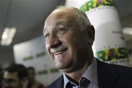 Soccer coach Luiz Felipe Scolari speaks during a media conference after a meeting with Brazil's Sports Minister Aldo Rebelo in Brasilia September 25, 2012. REUTERS/Ueslei Marcelino/Files